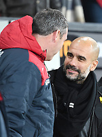 Football - 2017 / 2018 Premier League - Swansea City vs. West Bromwich Albion<br /> <br /> Swansea City manager Paul Clement & Manchester City manager Pep Guardiola before the game on the touchline, at The Liberty Stadium.<br /> <br /> COLORSPORT/WINSTON BYNORTH