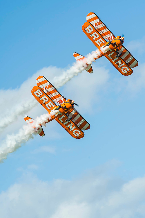 The Breitling Wing Walkers do an acrobatic display - Red Bull Air Race World Championships at Ascot Race Course. A combination of high speed, low altitude and extreme manoeuvrability make it only accessible to the 'world's most exceptional pilots'. 12 pilots compete in the Master Class category in eight races across the globe for the title of 2014 Red Bull Air Race World Champion. The objective is to navigate an aerial racetrack featuring air-filled pylons in the fastest possible time, incurring as few penalties as possible. All 12 pilots race with a standardised propulsion package – a high-performance, race-tuned standardised engine (Lycoming Thunderbolt) and standardised propellers (Hartzell 3-bladed). They do have a chooice of 3 single engine/seater aircraft - the Zivko Aeronautic Edge 540, the MXS-R and the Hungarian University of Aviation's Corvus Racer 540 - all cappable of around 230kts and of surviving high G forces, 10+. A new feature of the 2014 Red Bull Air Race World Championship is the debut of the new Challenger Cup, giving a new generation of talented pilots from around the world a chance to race. Entertainement is provided by the Red Arrows and the Breitling Wingwalkers, amongst others.  Ascot Racecourse, High St, Ascot, Berkshire, UK.