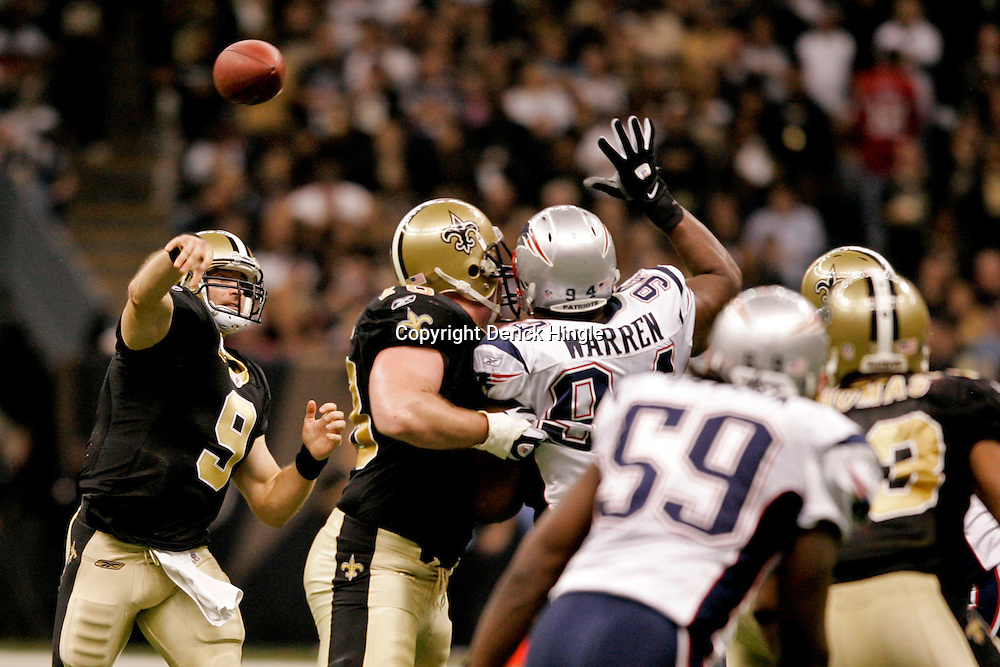 2009 November 30:  New Orleans Saints quarterback Drew Brees (9) throws a touchdown pass to New Orleans Saints wide receiver Marques Colston (not pictured) during the second half against thye New England Patriots at the Louisiana Superdome in New Orleans, Louisiana.