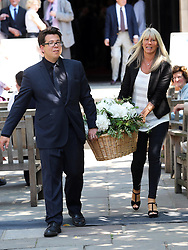 Michael McIntyre helps to bring out flowers from St.Paul's Church in Covent Garden, London, after a memorial service for the actor Simon Ward who is the father of his wife Kitty,  Tuesday, 9th July 2013<br /> Picture by Stephen Lock / i-Images