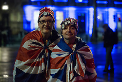 London, UK. 31 January, 2020. Royal superfan John Loughrey (r) and a friend prepare to attend the Leave Means Leave rally in Parliament Square organised for the evening on which the UK leaves the European Union.