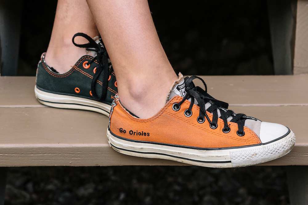 "Meredith Case Ellison, 13, a Washington D.C. resident and lifelong Orioles fan, ordered custom orange and black Converse shoes with the slogan ""Go Orioles"" stitched into the side."