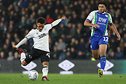 Derby County midfielder Duane Holmes strikes at goal during the EFL Sky Bet Championship match between Derby County and Wigan Athletic at the Pride Park, Derby, England on 5 March 2019.