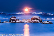 """Moonset at Sand Harbor 2"" - The moon sets over the Sierra Nevada Mountains and Lake Tahoe's Sand Harbor."