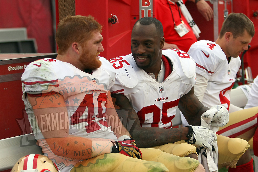 San Francisco 49ers fullback Bruce Miller (49) and San Francisco 49ers tight end Vernon Davis (85)  during an NFL football game between the San Francisco 49ers  and the Tampa Bay Buccaneers on Sunday, December 15, 2013 at Raymond James Stadium in Tampa, Florida.. (Photo/Alex Menendez)