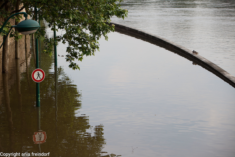 Flooding of river Seine, may cost French insurance companies more than $2 billion, The Seine's water levels fell Sunday as rains eased. A reading indicated it was near the mark, reached in 1982, of 20.27 feet above its normal level, the Environment and Energy Ministry reported. France creates emergency fund for people affected by floods. About 6,000 French homes remained without electricity Monday, and several train stations and roads were still closed in the French capital and surrounding towns. Flooded city road sign