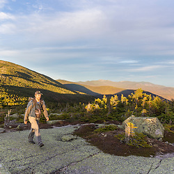 Hiking the Appalachian Trail on Saddleback Mountain in Maine's High Peaks Region. The summit of The Horn is in the background.