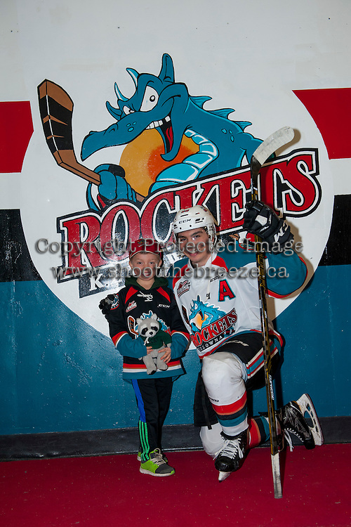 KELOWNA, CANADA - FEBRUARY 13: Nick Merkley #10 of the Kelowna Rockets stands with the honorary stick boy against the Seattle Thunderbirds on February 13, 2017 at Prospera Place in Kelowna, British Columbia, Canada.  (Photo by Marissa Baecker/Shoot the Breeze)  *** Local Caption ***