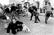 Skinheads fighting with Anti-Nazis at Waterloo station during a picket, to stop a rendezvous for a skinhead gig. London 12/9/1992