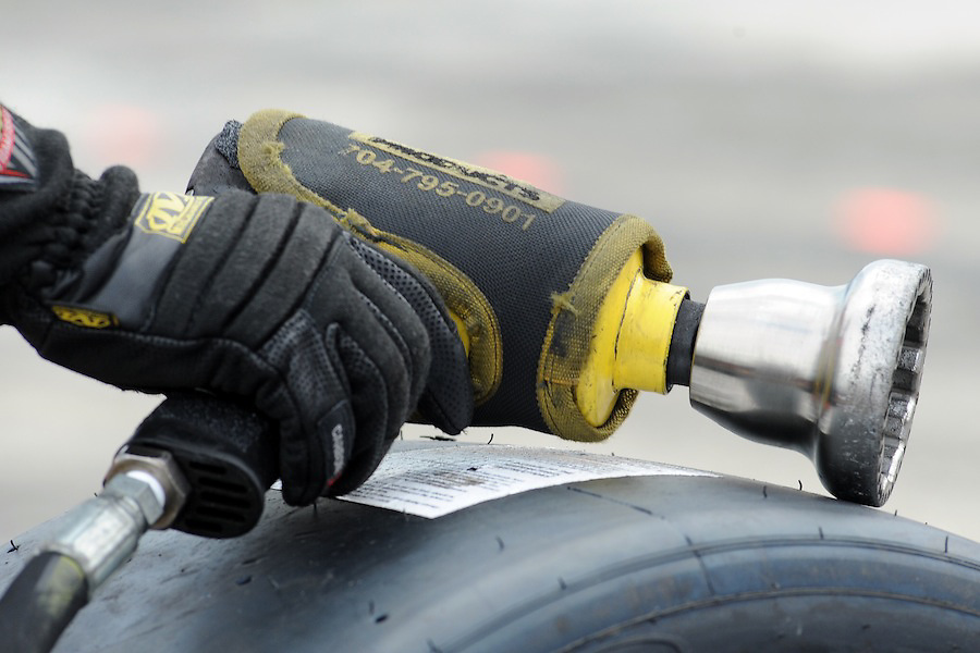 5 June 2010: A crew member from the Action Express Racing team grasp the air gun while waIting to perform a mid race pit stop during the Sahlen's Six Hours of the Glen at Watkins Glen, New York..Mandatory Credit: Michael Johnson / Southcreek Global