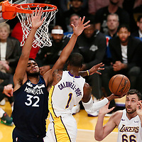 25 December 2017: Los Angeles Lakers guard Kentavious Caldwell-Pope (1) passes the ball to Los Angeles Lakers center Andrew Bogut (66) during the Minnesota Timberwolves 121-104 victory over the LA Lakers, at the Staples Center, Los Angeles, California, USA.