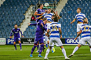 Portsmouth defender Christian Burgess (6) heads towards the goal from the free kick resulting from the challenge on Portsmouth defender Ross McCrorie (15) during the EFL Cup match between Queens Park Rangers and Portsmouth at the Kiyan Prince Foundation Stadium, London, England on 28 August 2019.