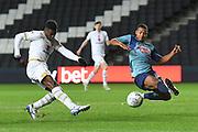 Milton Keynes Dons striker Kieran Agard (14) sees his shot blocked by Wycombe Wanderers midfielder Nick Freeman (22) during the EFL Trophy match between Milton Keynes Dons and Wycombe Wanderers at stadium:mk, Milton Keynes, England on 12 November 2019.
