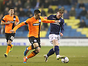 Striker Aiden O'Brien and Beram Kayal, Brighton midfielder during the Sky Bet Championship match between Millwall and Brighton and Hove Albion at The Den, London, England on 17 March 2015.