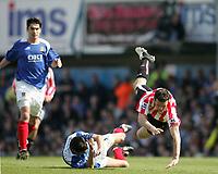 Photo: Lee Earle.<br /> Portsmouth v Sunderland. The Barclays Premiership. 22/04/2006. Sunderland's Tommy Miller is sent flying by Dejan Stefanovic.