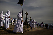 """Penitents take part in a procession of """"Santo Cristo"""" during the Holy Week in Bercianos de Aliste, northern Spain, Friday, April 3, 2015. Hundreds of processions take place throughout Spain during the Easter Holy Week."""
