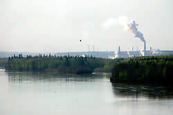 CANADA ALBERTA FORT MCKAY 13MAY07 - View of the Suncor plant and the Athabasca river near Fort McKay in northern Alberta, Canada...The Alberta Tar Sands are the largest deposits of their kind in the world and their production is the single largest contributor to Canada's greenhouse gas emissions...Alberta's tar sands are currently estimated to contain a crude bitumen resource of 315 billion barrels, with remaining established reserves of almost 174 billion barrels, thus making Canada's oil resources ranked second largest in the world in terms of size...The industry has brought wealth and an economic boom to the region but also created an environmental disaster downstream from the Athabasca river, polluting the lakes where water and fish are contaminated. The native Indian tribes of the Mikisew, Cree, Dene and other smaller First Nations are seeing their natural habitat destroyed and are largely powerless to stop or slow down the rapid expansion of the oil sands development, Canada's number one economic driver...jre/Photo by Jiri Rezac / WWF-UK..© Jiri Rezac 2007..Contact: +44 (0) 7050 110 417.Mobile: +44 (0) 7801 337 683.Office: +44 (0) 20 8968 9635..Email: jiri@jirirezac.com.Web: www.jirirezac.com..© All images Jiri Rezac 2007 - All rights reserved.