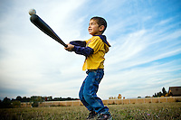 JEROME A. POLLOS/Press..Isaiah Gallegos, 5, watches his bat make contact with a ball during a quick game of baseball Monday in Dalton Gardens. As a polar storm brings in cold and wet weather, many took to the outdoors Monday to enjoy the 70-degree temperatures.
