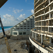Construction site by the beach. Cancun, Quintana Roo. Mexico.