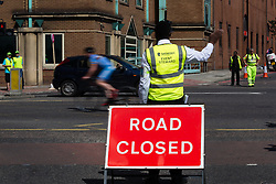 © Licensed to London News Pictures. 07/07/2014. London, UK. A steward directs traffic off the Highway approach to Tower Hill in East London as roads are closed in preparation for the Tour de France Stage 3 in London. Photo credit : Vickie Flores/LNP