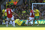 Picture by Paul Chesterton/Focus Images Ltd.  07904 640267.19/11/11.David Fox of Norwich tackles Arsenal's Aaron Ramsey during the Barclays Premier League match at Carrow Road stadium, Norwich.