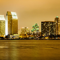 Photo of San Diego at night with downtown San Diego city buildings along San Diego Bay. Image is high resolution and was taken in 2012.