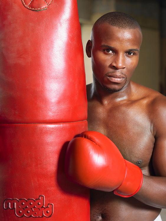 Boxer holding punching bag portrait