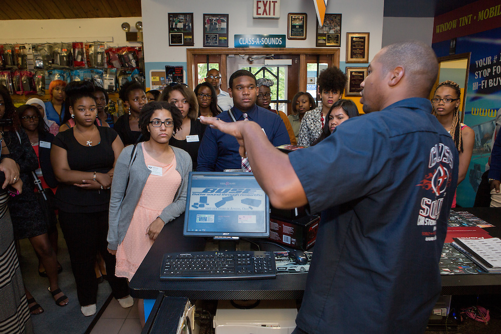 Aaron Thomas, owner of Class A Sounds, speaks to participants in Ohio University's Junior Executive Business Program at his store on July 14, 2014. Photo by Lauren Pond