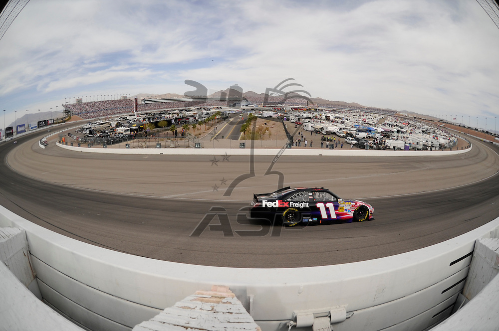 LAS VEGAS, NV - MAR 11, 2012:  The NASCAR Sprint Cup teams take to the track for the running of the Kobalt Tools 400 race at the Las Vegas Motor Speedway in Las Vegas, NV.