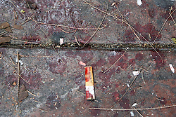 © Licensed to London News Pictures. 19/01/2014. A cigarette butt covered in blood at the scene of a grenade attack .The grenade attack has reportedly injured 28 people at the protest site at the Victory Monument in Bangkok Thailand. Anti-government protesters launch 'Bangkok Shutdown', blocking major intersections in the heart of the capital, as part of their bid to oust the government of Prime Minister Yingluck Shinawatra ahead of elections scheduled to take place on February 2. Photo credit : Asanka Brendon Ratnayake/LNP