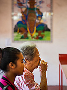 15 NOVEMBER 2016 - GEORGE TOWN, PENANG, MALAYSIA: Women pray in the Temple of the Goddess of Mercy in George Town, Penang. George Town is a UNESCO World Heritage city and wrestles with maintaining its traditional lifestyle and mass tourism.           PHOTO BY JACK KURTZ