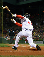 Red Sox Orlando Cabrera gets a hit in Game 5, ALCS, Fenway Park, Boston.  2004 Boston Red Sox, make a run at history getting through a tough fight with the New York Yankees and then eventually sweeping the St. Louis Cardinals for the World Series title.