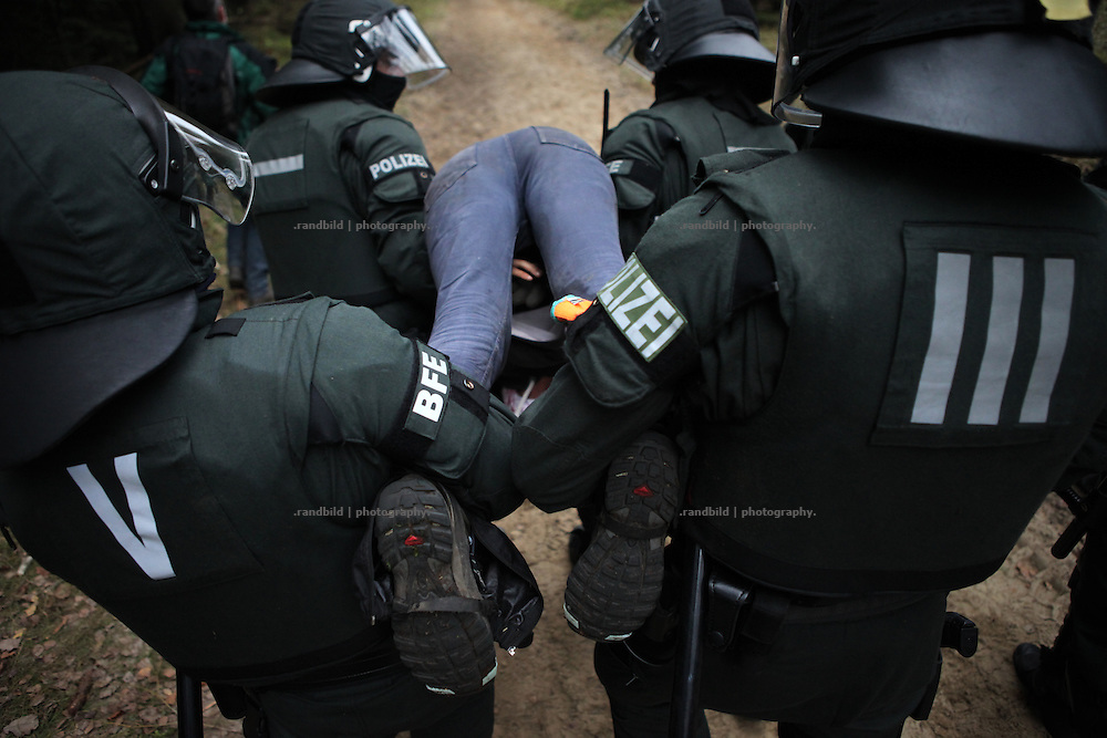 Injured demonstraters get arrested by police in the woods where hundreds of anti nuclear activists tried to block a Castor transport to Gorleben.