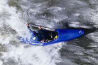 Kayaker paddling through Rapids overhead view