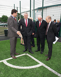 NEWPORT, WALES - Wednesday, July 4, 2012: Welsh Football Trust Chief-Executive Neil Ward, First Minister Carwyn Jones, Newport Council Leader Bob Bright and FAW Chief-Executive Jonathan Ford open the first 3G pitch at the National Development Centre at the Newport International Sports Village. (Pic by David Rawcliffe/Propaganda)