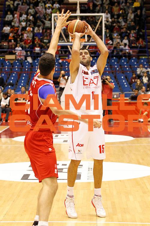 DESCRIZIONE : Milano Lega A 2012-13 EA7 Emporio Armani Milano Trenkwalder Reggio Emilia<br /> GIOCATORE : Ioannis Bourousis<br /> CATEGORIA : Tiro Three Points<br /> SQUADRA : EA7 Emporio Armani Milano<br /> EVENTO : Campionato Lega A 2012-2013<br /> GARA : EA7 Emporio Armani Milano Trenkwalder Reggio Emilia<br /> DATA : 28/10/2012<br /> SPORT : Pallacanestro <br /> AUTORE : Agenzia Ciamillo-Castoria/G.Cottini<br /> Galleria : Lega Basket A 2012-2013  <br /> Fotonotizia : Milano Lega A 2012-13 EA7 Emporio Armani Milano Trenkwalder Reggio Emilia<br /> Predefinita :