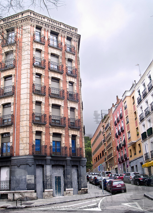 View of a common street and building in Madrid, Spain, on a cloudy day