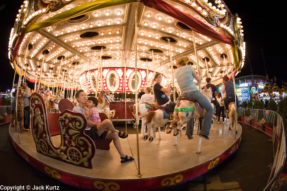 14 OCTOBER 2008  -- PHOENIX, AZ: The Merry Go Round at the Arizona State Fair. The Arizona State Fair started Oct.  10 and runs through Nov. 2. Carnival and midway workers who have worked the fair for years say attendance so far is much lower than in the past and people at the fair this year aren't spending as much money as they have in the past. PHOTO BY JACK KURTZ