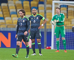 KIEV, UKRAINE - Easter Monday, March 28, 2016: Wales' Joe Allen, captain Ashley Williams and goalkeeper Wayne Hennessey look dejected as Ukraine score the opening goal during the International Friendly match at the NSK Olimpiyskyi Stadium. (Pic by David Rawcliffe/Propaganda)