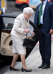 10/06/2013. London, UK. HRH Queen Elizabeth II, carrying a birthday card, arriving at The London Clinic on Harley Street, London to visit Prince Philip, Duke of Edinburgh, who is currently recovering after undergoing a planned operation to cure abdominal pains. Photo credit: Ben Cawthra