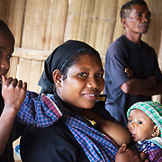 Olandina with her.baby Rovinhio.5 moths old. She has so far been doing exclusive breast feeding..Food is prepared for a Mother Support Group session where breast feeding mothers with 4 months plus babies learn about food supplements. Infant mortality rates are very high in Timor-Leste and one of the reasons for that is poor nutrition. Alola advocate breast feeding till at least two years old and teach women about nutritious supplements such as boiled and mashed rice w vegetables and eggs.  Fundasaun Alola is a not for profit non government organization operating in Timor Leste to improve the lives of women and children. Founded in 2001 by the then First Lady, Ms Kirsty Sword Gusmao, the organization seeks to nurture women leaders and advocate for the rights of women.