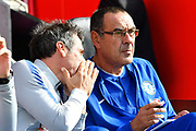 Chelsea assistant manager gianfranco zola talking to Chelsea manager Maurizio Sarri before the Premier League match between Southampton and Chelsea at the St Mary's Stadium, Southampton, England on 7 October 2018.