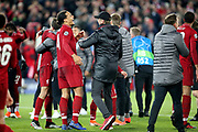 Liverpool defender Virgil van Dijk (4) shares a laugh with Liverpool Manager Jurgen Klopp after the 4-0 win during the Champions League semi-final, leg 2 of 2 match between Liverpool and Barcelona at Anfield, Liverpool, England on 7 May 2019.