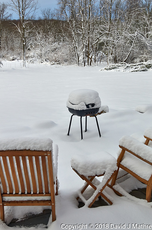 Snow covered patio chairs and grill. Image taken with a Leica TL-1 camera and 35mm f/1.4 lens (ISO 200, 35 mm, f/4, 1/1000 sec).