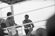 Ali vs Lewis Fight, Croke Park,Dublin..1972..19.07.1972..07.19.1972..19th July 1972..As part of his built up for a World Championship attempt against the current champion, 'Smokin' Joe Frazier,Muhammad Ali fought Al 'Blue' Lewis at Croke Park,Dublin,Ireland. Muhammad Ali won the fight with a TKO when the fight was stopped in the eleventh round...Picture shows Lewis missing with a wild right as Ali steps aside.