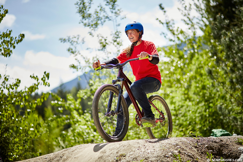 Trish Bromley sits on her bicycle at the dirt jumps in Whistler, British Columbia