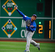 Chicago Cubs right fielder Kosuke Fukudome of Japan shows his arm in right field.