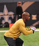 "New Orleans Saints Tracey Porter 22 (cb) seen stretching prior to the game against the Carolina Panthers. Porter has ""Hope""  cut out on right side of his head ""Faith"" on the left and :love on the neck and and orange ribbon for Breast Cancer Awareness Oct. 3,2010 prior to the Saints game against the Carolina Panthers. The NFL has gone ""Pink"" for October in honor of Breast Cancer Awareness. The Saints went on to win 16-14. John Carney kicked three field goals to help the Saints win. PHOTO©SuziAltman.com"