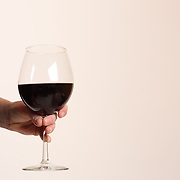 A pregnant women poses with a glass of red wine. Photo Tim Clayton