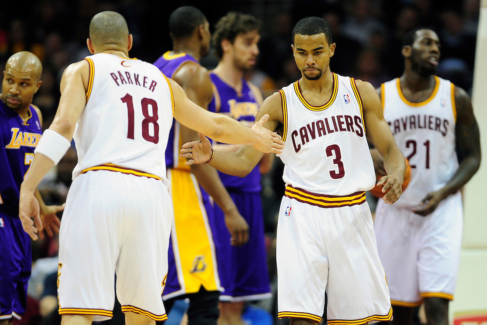 Feb. 16, 2011; Cleveland, OH, USA; Cleveland Cavaliers shooting guard Anthony Parker (18) celebrates with Cleveland Cavaliers point guard Ramon Sessions (3) during the first quarter against the Los Angeles Lakers at Quicken Loans Arena. Mandatory Credit: Jason Miller-US PRESSWIRE